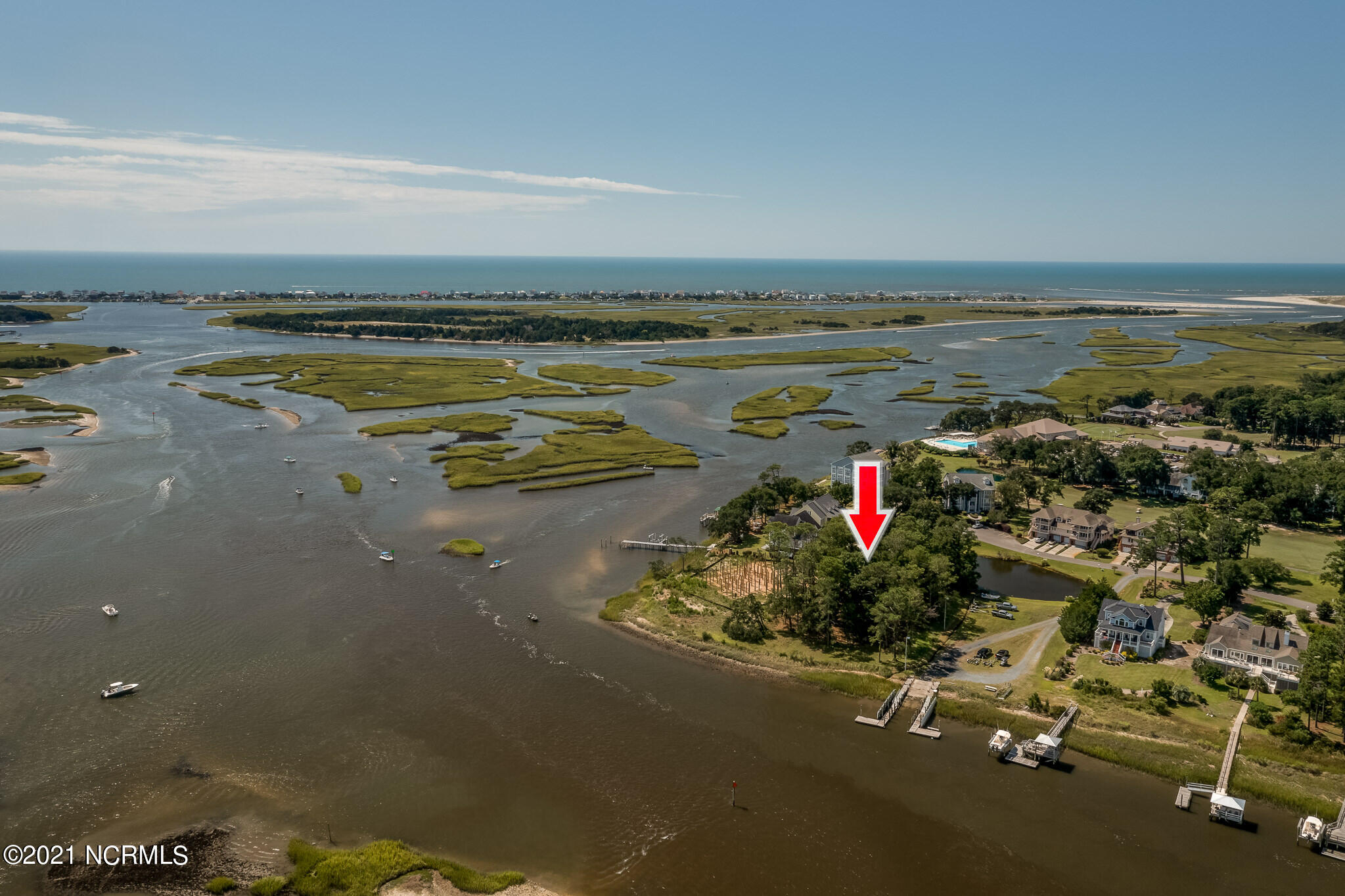 Prettiest waterfront deep water highly elevated lot in Lockwood Folly golf course plantation, .59 of an acre. 4 bedroom new septic permit on hand.   Walking distance to. golf course, pool and restaurant. will sell fast.  There are not many fantastic Holden Beach Waterfront homesites like this anywhere. This lot highly elevated in AE flood zone with spectacular waterfront, marsh front, sunset views of widest part of Lockwood Folly saltwater River where it meets the Intracoastal Waterway. Location is PREMIUM and will be the PERFECT homesite to build your waterfront home with waterviews from every window. small Lake in back yard. Next door to PlantaBoat Ramp, and so the connecting Bulkhead for Lockwood Folly is always maintained.  With CAMA permit can build a concrete pier. and boat lift. leave your lot by boat and you are in the Inlet and fishing the Atlantic for the big ones within 20 minutes. Bring all the fish back to your dock and clean them at your cleaning station on your pier. The crabs will love you. Look at all Drone footage to appreciate location and views. New Clubhouse. This is Sexy property and the pick of the litter. All Offers must have 5,000 Due Diligence to Seller.  Call for copy of septic permit. all homes in Lockwood Folly Plantation are custom built