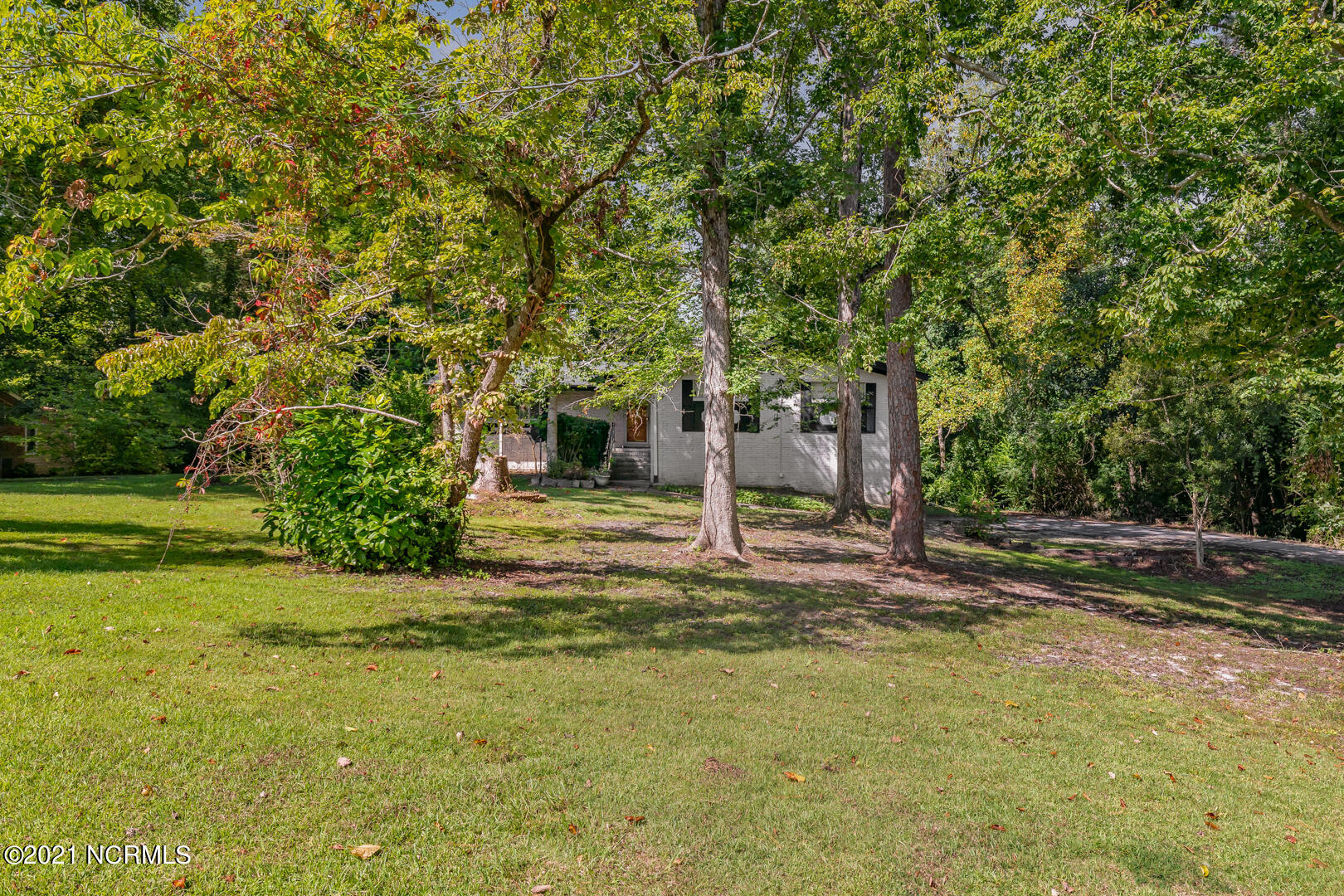 Tired of cookie cutter neighborhoods?  Looking for a home with personality that you can make yours?  HERE IT IS, with a $10,000 upgrade allowance!!  Country Club Acres is an established neighborhood located in the heart of Jacksonville, near area beaches, shopping and military bases. This home has tons of character with over 3000 heated square feet; mature trees and shrubbery surrounding the property, small creek running behind the home, two-car garage, a full basement, insulated interior walls, and much more! On the main living area of your new home you find three bedrooms, two bathrooms, a large living space with hardwood floors, kitchen with stainless steel appliances, fireplace with small area boasting outlets at the floor & high on the wall to allow your imagination to become reality with whatever you choose to do with it, tons of closet space and just under an acre of land! The finished basement is an entertainer's dream, two large open areas, 11x7 room, full bath, storage closets, and laundry room.  Don't miss out, make your appointment--TODAY!
