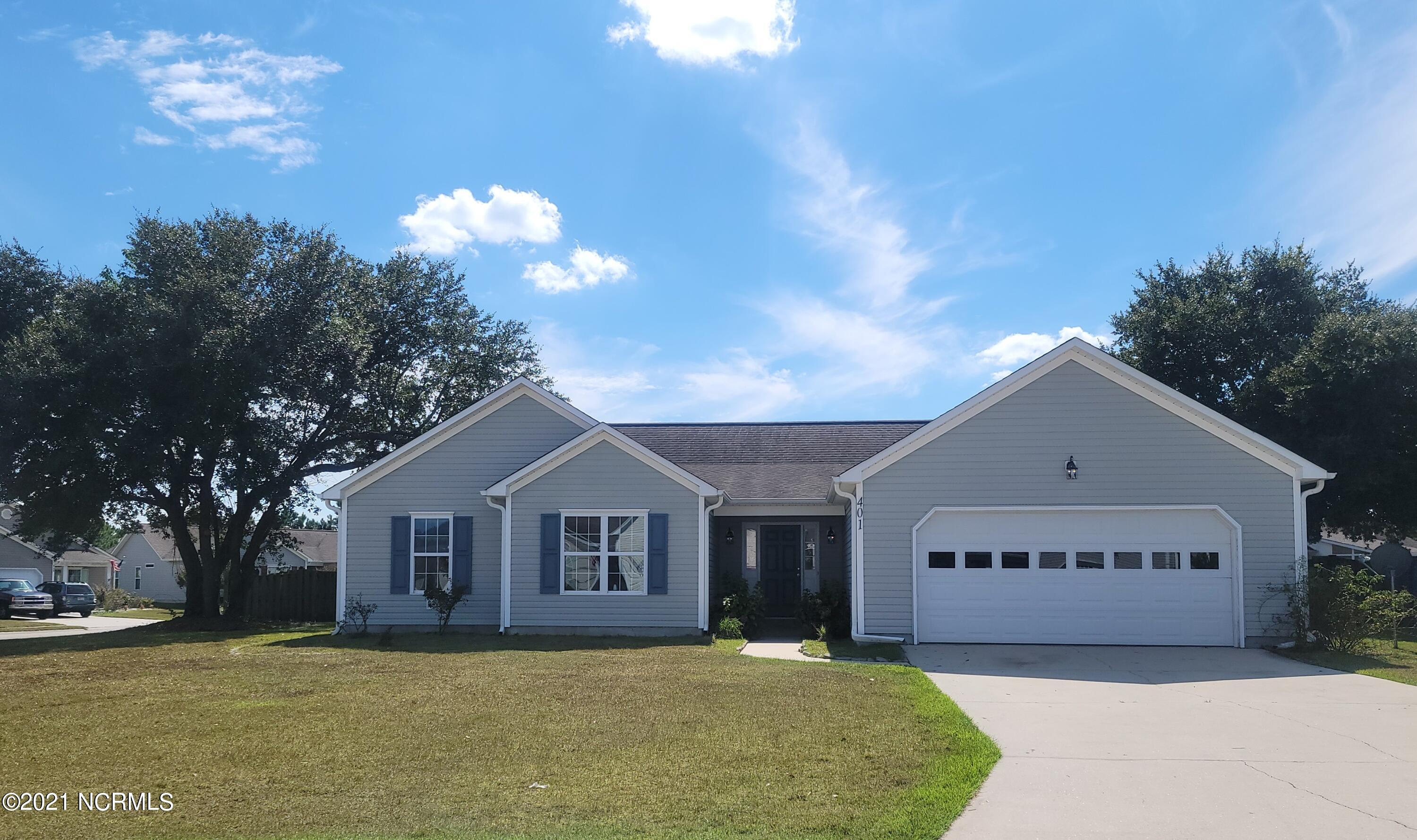 This 3 bedroom, 2 bath home is located in The Neighborhoods of Holly Ridge, only minutes from beaches, MARSOC, Stone Bay, and Camp LeJeune. Home sits on a nice, large corner lot! Walk in the front door to a spacious living room that features a gas fireplace.  There is a nice flowing concept from the living area to the kitchen and dinning room.  When entering from the two car garage, you walk in to the laundry room that then enters the kitchen. Spacious master bedroom suite, walk-in closet and a master bath with dual vanities, stand up shower, and a large bathtub. Bedroom two and three share a very nice hall bathroom with a shower/tub combo. Linen closet in this hall as well. Relax on your covered back porch overlooking a spacious fenced in backyard.  Luxury vinyl plank flooring throughout the home. Kitchen has new cabinets, countertops, and a new stove and microwave.  Bathrooms have new vanities.  Whole home has been freshly painted and covered back patio will be screened in!  Neighborhood features include park/picnic area, sidewalks & more. This charming home is a perfect place to call home or a great second home getaway being less than 5 miles to the beautiful beaches of Topsail Island. Schedule your showing before this one is gone!!  ***We are in a multiple offer situation.  Please submit final and best by Tuesday at 5 p.m. 10/19/21.***