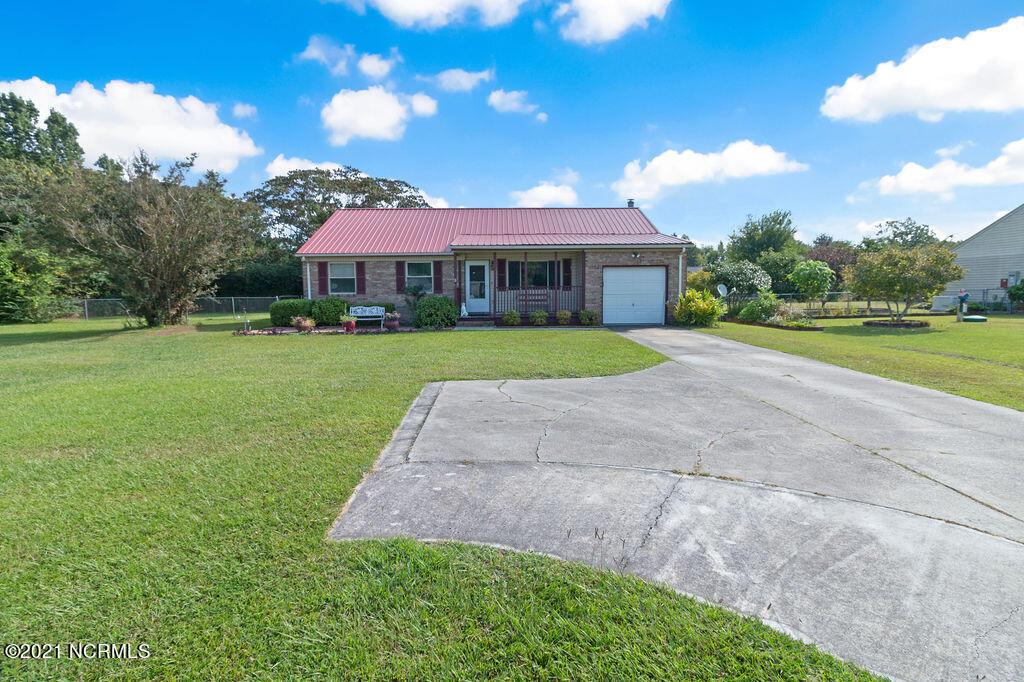 Check out this pristine home located just minutes from Jacksonville city limits! The exterior features well manicured landscaping, a metal roof, a parking pad, one car garage, fenced back yard, storage shed and 16x16 deck. Step inside and admire the large open living room that flows into the kitchen.The kitchen offers ample counter/cabinet space and includes a range/oven and dishwasher. Just off the kitchen you'll find another living space with a fireplace that can be used as a dining area or sitting area. Down the hall you'll find an updated guest bathroom and two guest rooms. The main bedroom is also located at the end of the hallway and features a private ensuite bathroom with walk in shower. Don't wait on this one! Call to see it today!