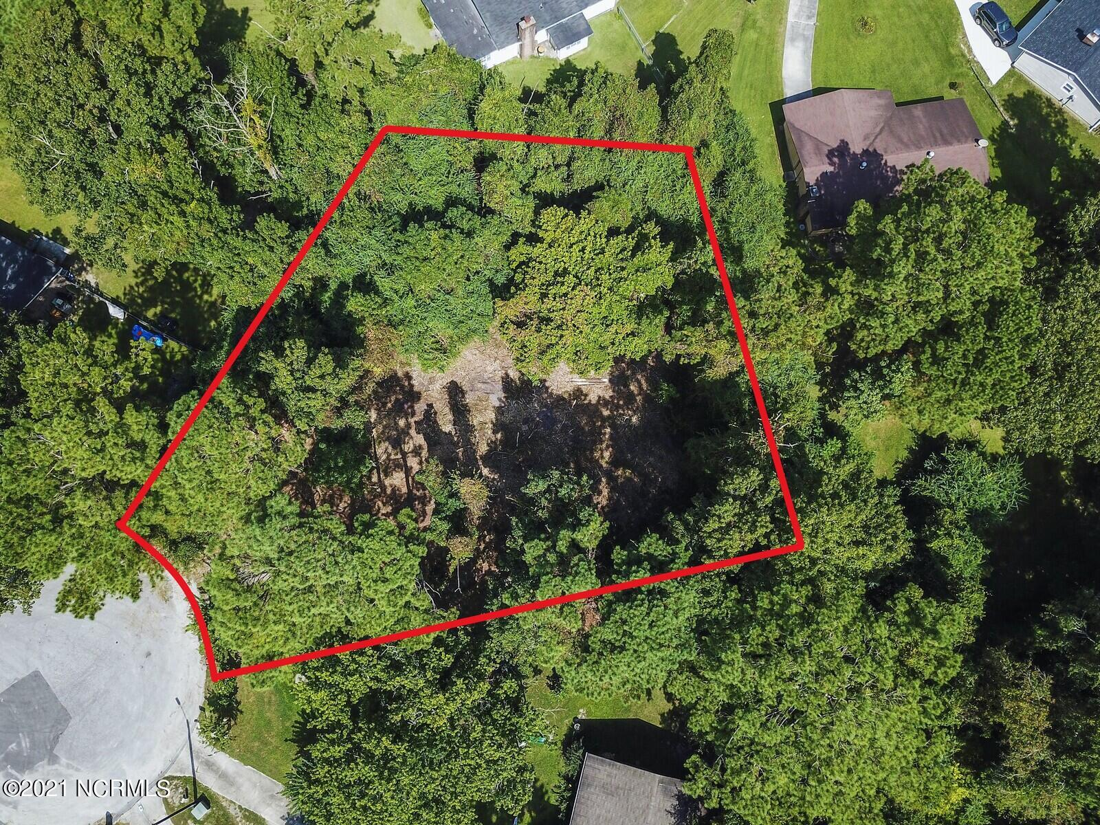Property was just freshly cleared and cut for an easy perk test! Now is your chance to build in this prime .28 acre lot! A perfect spot for you and the family, just 10 miles away from Camp Lejeune's Main Gate. Less than 30 minutes south of North Topsail Beach or about 55 minutes north of Wrightsville beach - there are plenty of activities awaiting you here in this growing community with a variety that caters to everyone; whether it be outdoor recreation, shopping downtown, dining at one our many amazing restaurants, boating down New River & Stones Bay toward Wilmington until reaching the Intracoastal Water Way towards Topsail.I can tell you that there are public water sources, a septic tank will be needed and access to local electric utilities. 1983 is the last time the covenants were updated with building restrictions so I have uploaded them for your review as well!