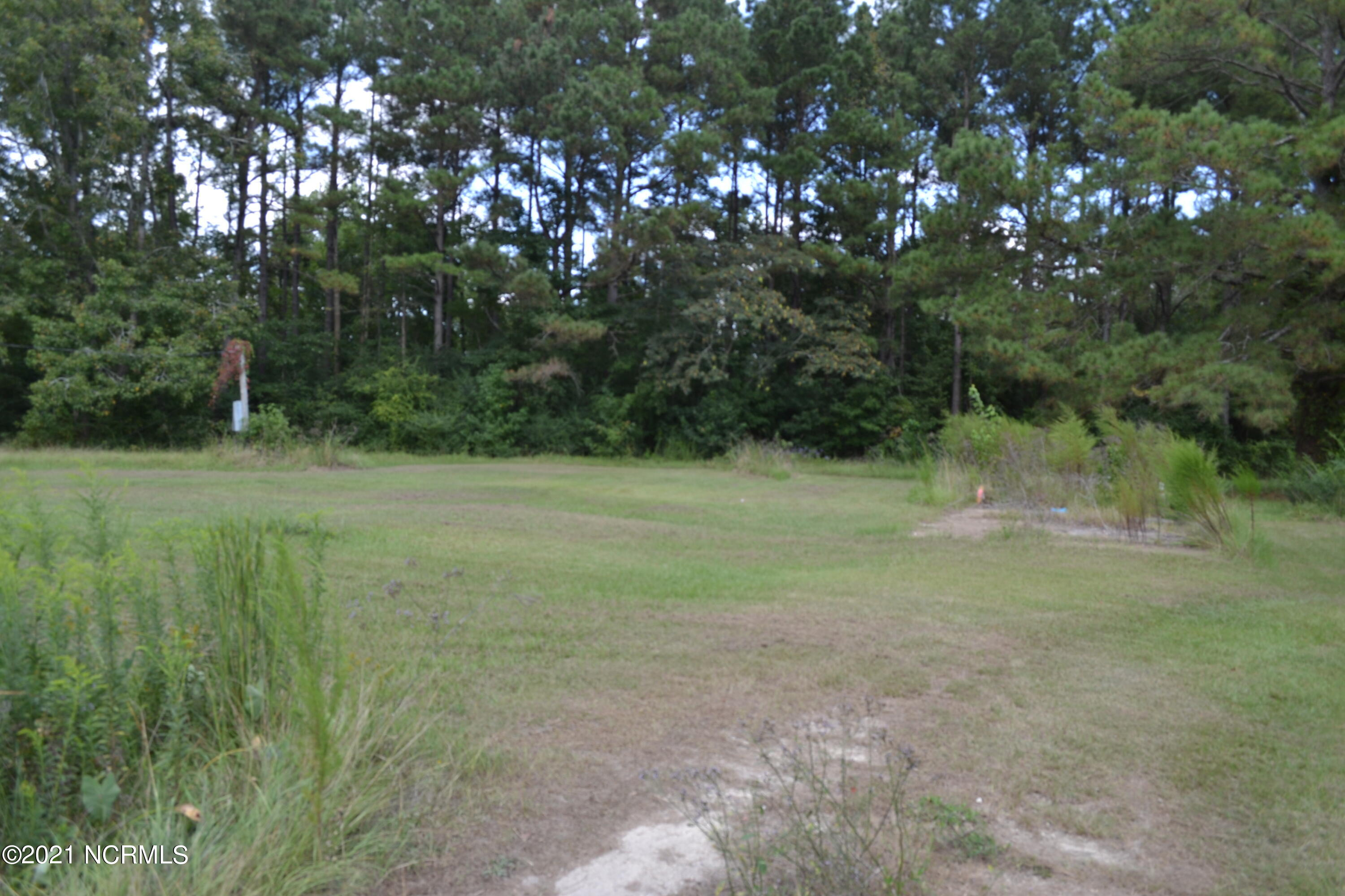Are you seeking an ideal location to build your next home? The partially cleared lot is ready for you. It had previously had a mobile home.  Additionally the lot has electric hook up on site.