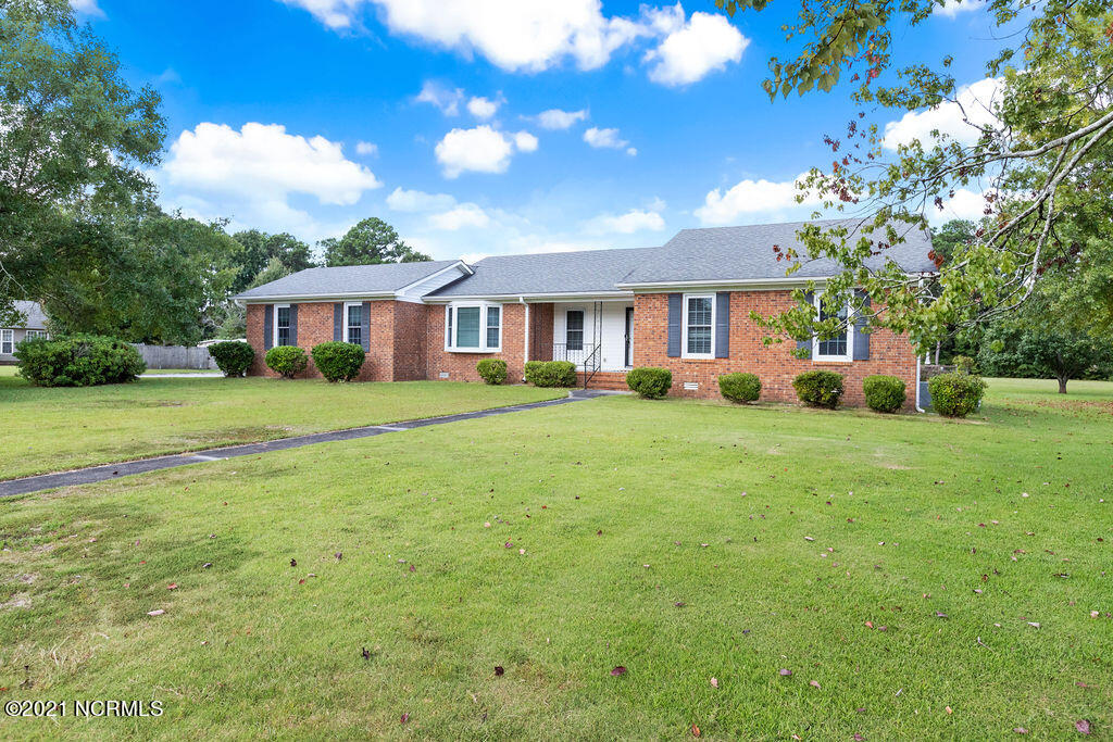 This lovely brick home has great curb appeal with a corner lot and an established yard with mature trees! It offers a prime location in the midst of all that Jacksonville has to offer with being in walking distance to Coastal Carolina Community College. The home features a large family room with a brick fireplace, a office/bonus room with a bay window, a fully equipped kitchen and a dining room. The home has a 2 car garage, front porch and a back deck. Come see what all this home has to offer!