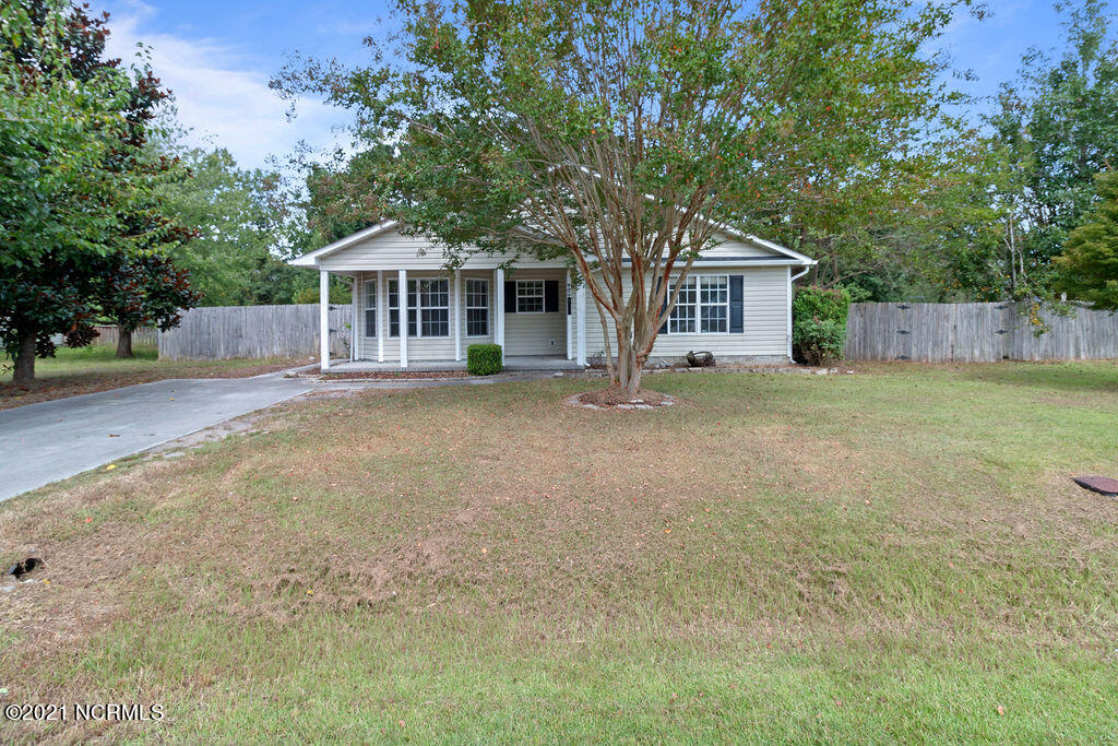 Here's an amazing find in our Jacksonville market! This 4 bedroom 2 bath home is centrally located and close to Camp Lejeune, schools, shopping, and area parks. You'll find this home features new carpeting, laminate flooring in the kitchen and dining room for easy cleanup, granite counters in the kitchen and guest bathroom, a spacious family room with a gas fireplace, a formal dining room, and a very large fully fenced backyard. This home is MOVE-IN so don't hesitate and call for your personal or virtual home tour TODAY!