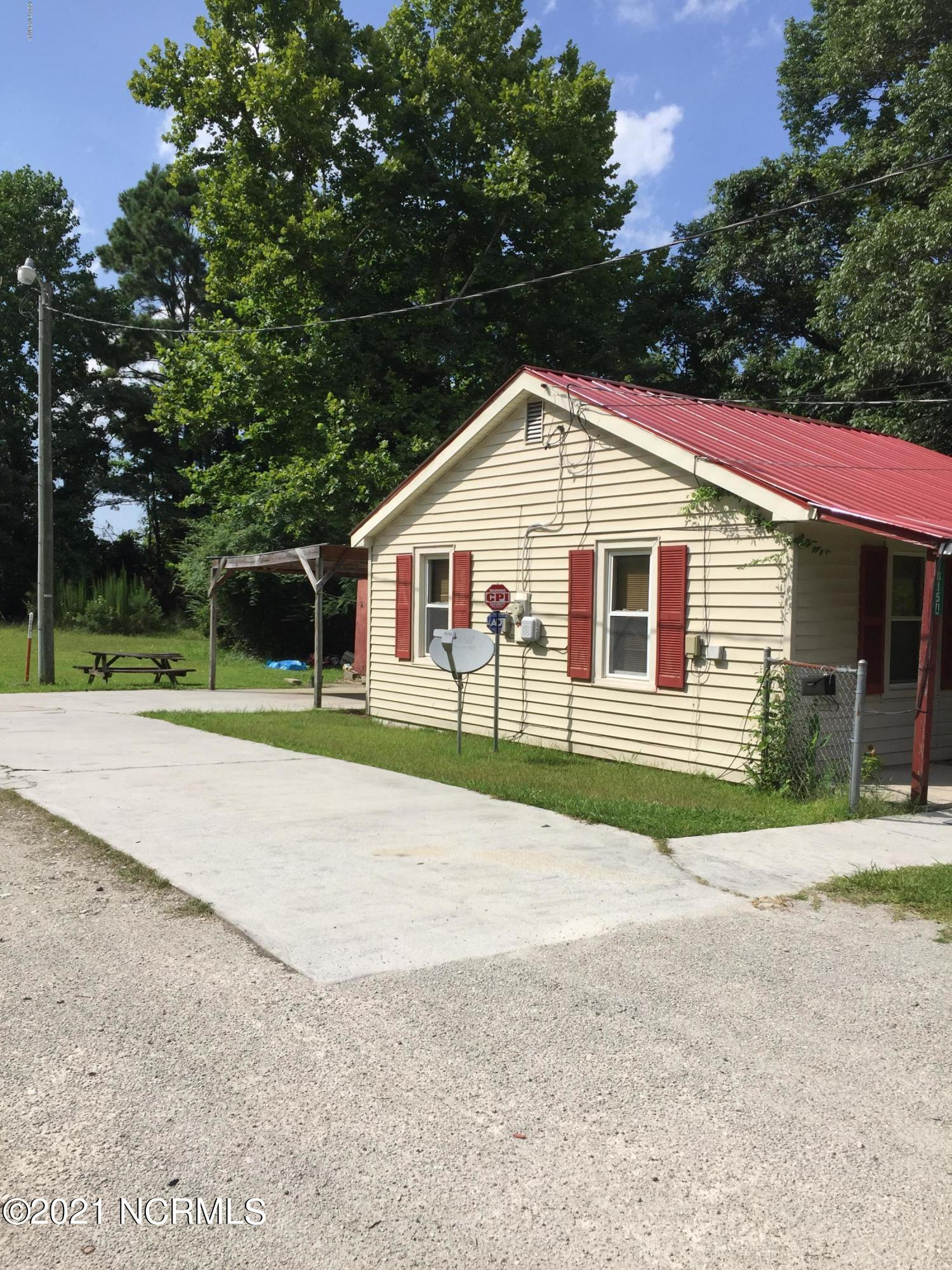 This property is a 2 bedroom 1 bath home that is zoned commercial that could have multiple uses.  If purchased as a residential property will only be cash or conventional loan.  Would make a great tattoo parlor/salon, etc.