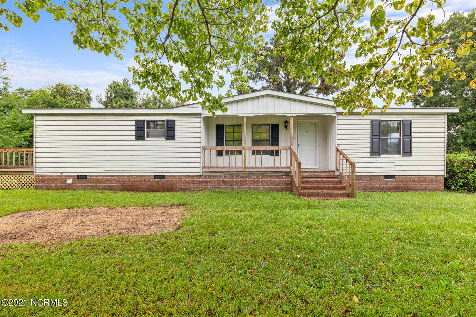 Come see this well cared for home that sits on over half an acre! With 3 bedrooms, 2 full bathrooms and a large living space everyone will have room to stretch out!. A few of the favorite features are the split floor plan, large master bedroom and the deck perfect for grilling on. Be sure to schedule your appointment today!
