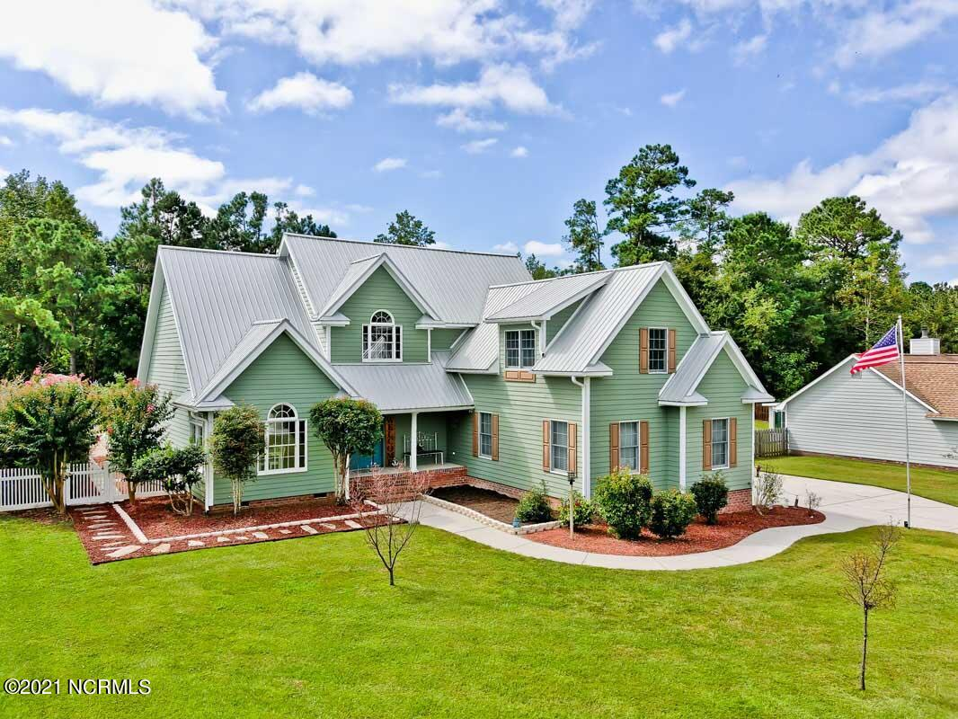 Your forever home has just become available in the beautiful White Oak river front community of River Reach.  Nestled just outside of Swansboro's historic waterfront district you will find this gorgeous custom built home that has more to offer than any other property in this price range! Starting with a 16x32 in ground pool w/ solar cover, outdoor kitchen, hot tub, outdoor shower, 3 season room, covered decks on either side with IPE decking, pristine landscaping, metal roof , vapor barrier and dehumidifier in crawl space, storage shed, and that is just outside.  Step inside to a recently upgraded chef's kitchen boasting quartz counter tops and mosaic tile floors.  A well laid out main floor offers a huge open concept kitchen with an island, both formal & informal dining as well as an office nook with tons of natural light. New interior paint in the upstairs and downstairs main living areas look great against the Brazilian cherry floors.  All the bathrooms were redone in 2019.  First floor master suite and laundry room make life easy and convenient.  The second level has an additional living area, a home school area, two large bedrooms w/ walk in closets, and a ginormous recreational room with endless options of use.  Living in a community with a boat ramp, fishing pier & cleaning station, floating dock, bath house, and nature pasture rounds out what makes this property the one you and your family will want to spend the rest of your days in.  NOTE:  Many additional upgrades, features, and conveying furniture along with extra appliances will be listed in the MLS documents. There are 2000 tulip bulbs planted, too!