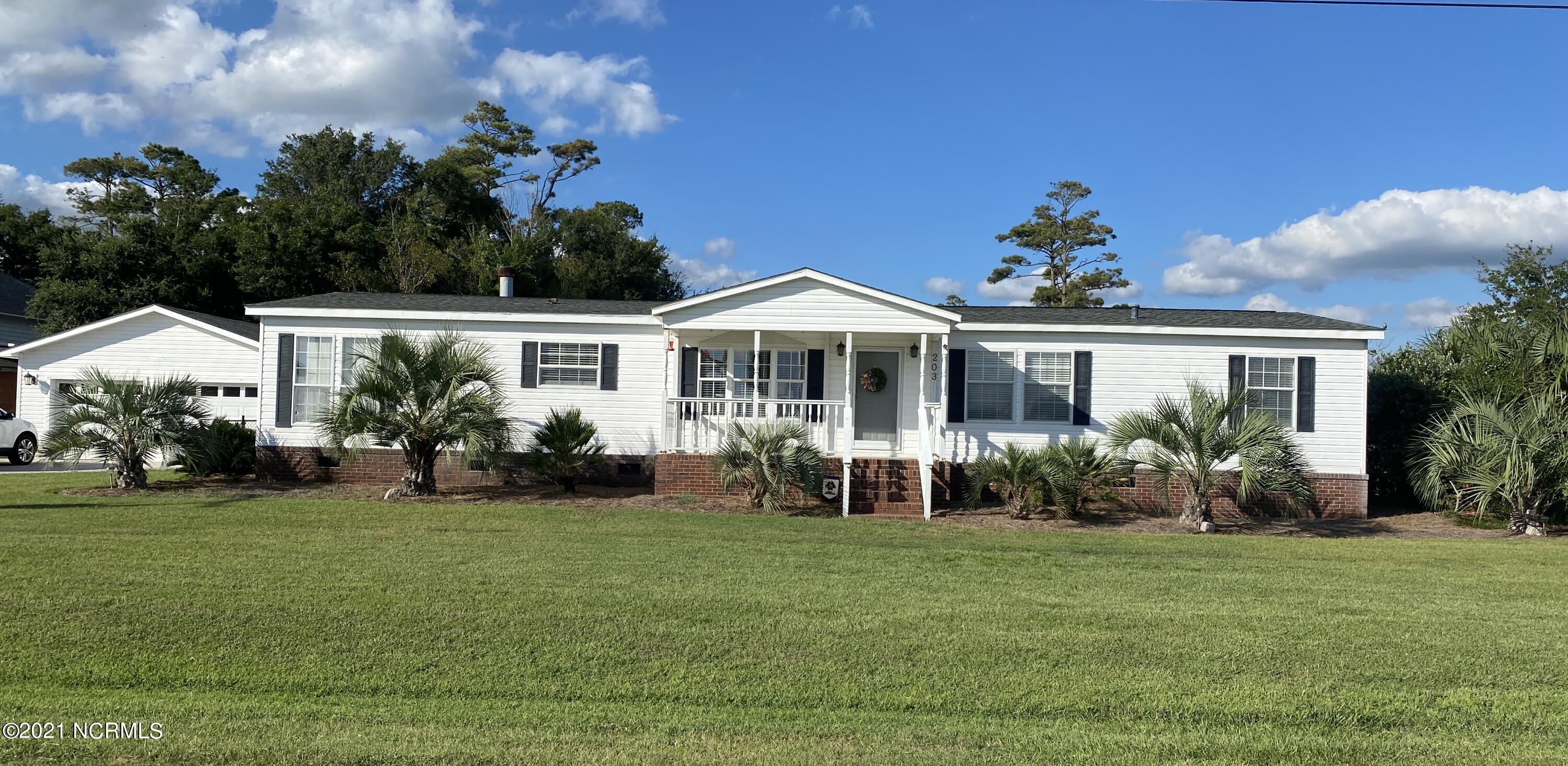Oh my, Honey Stop the Car!! Enjoy living in Carteret County with water views and affordable. Live in the highly sought-after area of Bayshore Park. This home is located just a block from the community boat ramp (membership required to use).  The home is a 3-bedroom, 2 bath with new, within the last year, luxury vinyl flooring.  Gas logs for those cool coastal nights. The home features two spacious living areas.  Large kitchen with granite countertops and breakfast bar. This property also has a 2-car detached garage and a backyard storage building.  The driveway offers plenty of room for your camper/RV and the property has a 220 plug.  Bring your boat on down to Cape Carteret and make this jewel your next beach home.  Located close to schools, restaurants, grocery stores, beaches. Call for an appointment today.