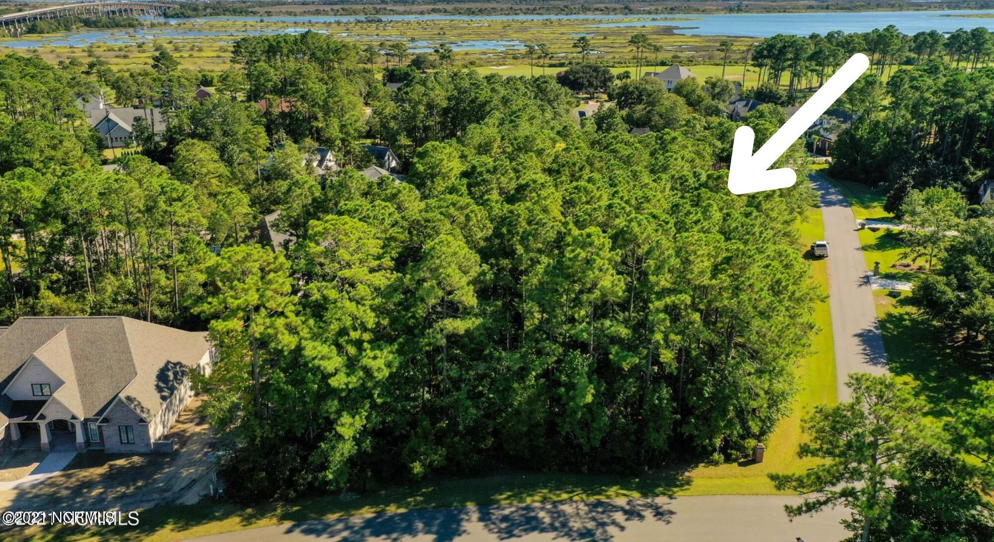 Large corner lot in the exclusive subdivision of North Shore Country Club.   Membership is available to purchase for Golf, Pool and Tennis.  Minutes to the beaches!   Come build your dream home.