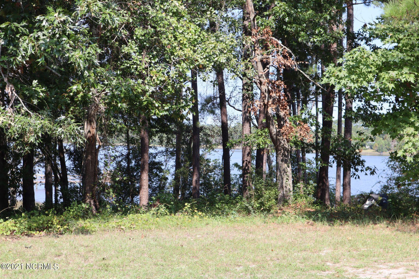 Beautiful high waterfront lot just for your dream home. There is plenty of room to build above the flood zone so no fear there. Launch your kayaks or boat and see all nature has to offer. This lot is close to the quaint town of Swansboro and a short drive to the beautiful beaches of the Crystal Coast.