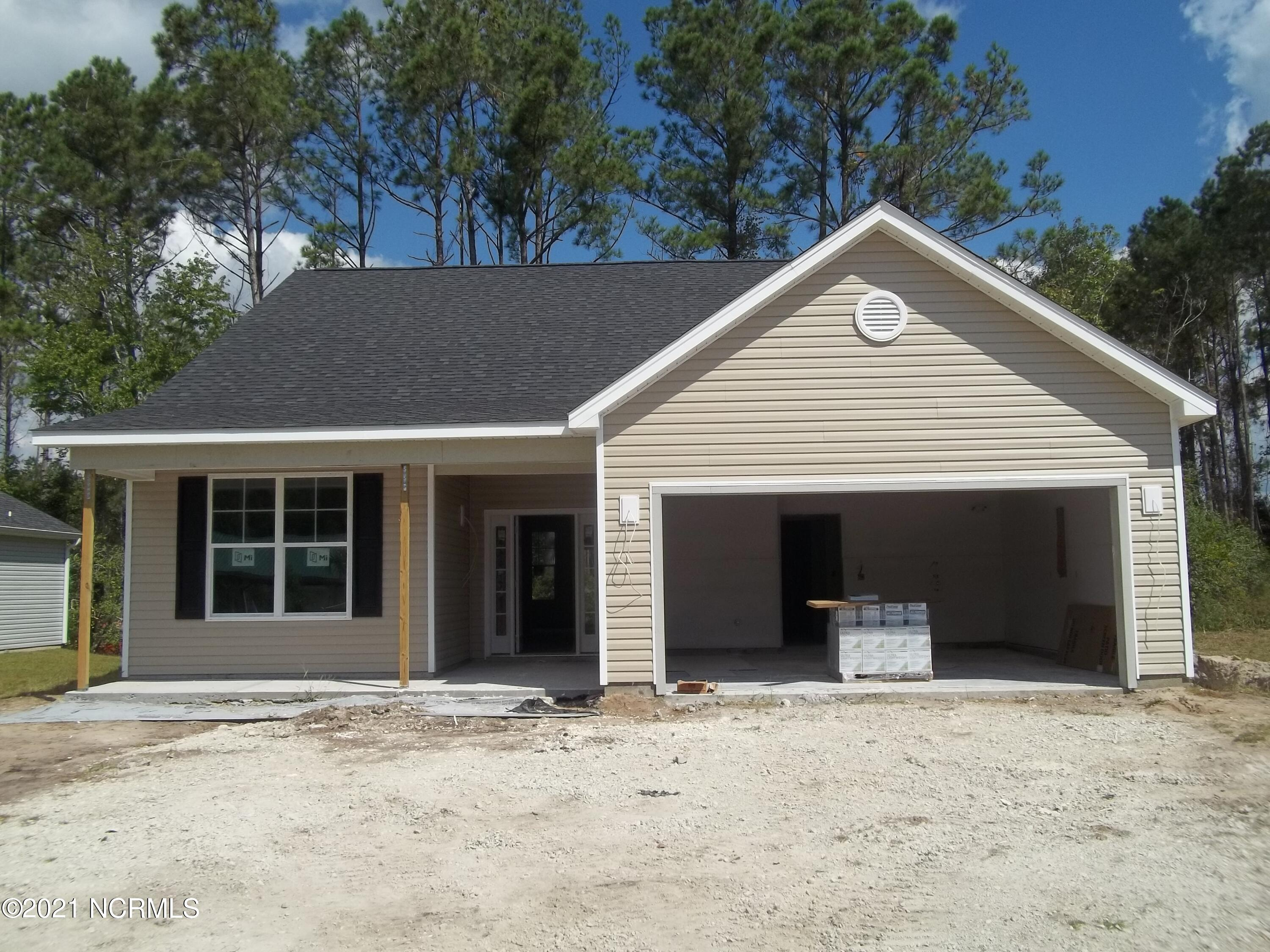 Check out this neat new construction home in one of Hampstead's most sought after communities.  The Somerset Plan combines the easy living ranch plan but is equipped with an upstairs bedroom, bathroom and bonus room.  The Arbors is located conveniently between Wilmington and Jacksonville and just a short drive to Topsail Beaches.  Pender County School district.   Homesite 62 sits right across the street from the community Pool! As you pull up, you will notice the covered front porch.   Inside you will be greeted with a downstairs master bedroom, along with two other bedrooms.   Interior futures will include LVP flooring, Tile in the wet areas, granite countertops, and stainless steel whirlpool appliance package.  WH2001