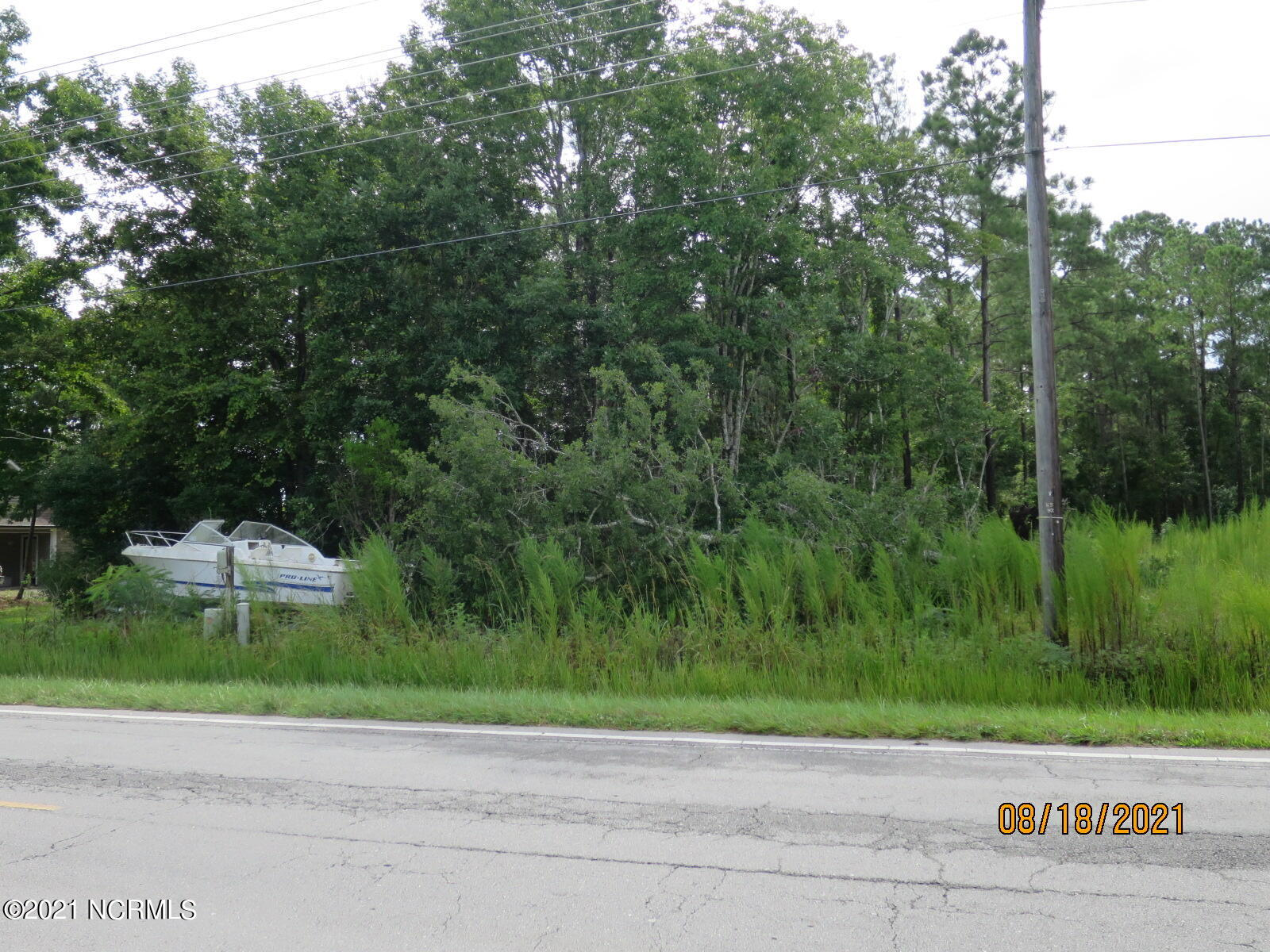 Don't miss out on this residential building lot in Sneads Ferry.  This lot has a 3 bedroom septic installed (installed in 1997, never used, buyer to verify condition) and municipal water available (all fees to be paid by buyer).  Close to area beaches on Topsail Island.  This location is also convenient to shopping, dining, and area military bases.  No HOA - room for your boat - unlike those tiny lots in most subdivisions.  Bring your house plans and builder and get started on making your coastal lifestyle dreams come true.