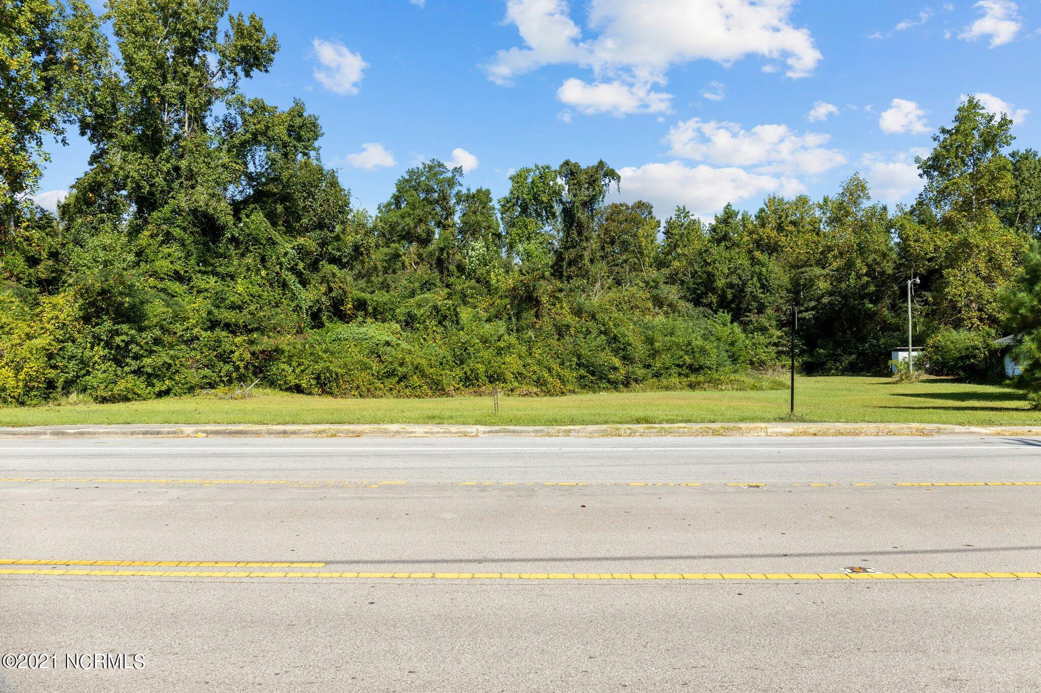Where are my Visionaries!? This parcel of land is partially cleared and ready for your home-based business. With 170 feet of commercial road frontage & being located in the heart of Jacksonville, this land has many possibilities. Did I mention this property is NOT located in a flood zone? Schedule your showing today!