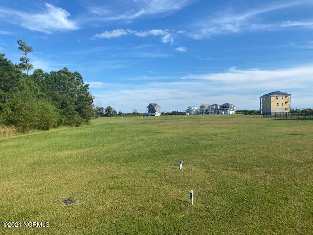 Beautiful building lot with waterviews if you build the right plan!  World class amenities in this gated community near the beach!  Come build your dream house and enjoy the best of coastal living!  Builder recommendations available upon request.