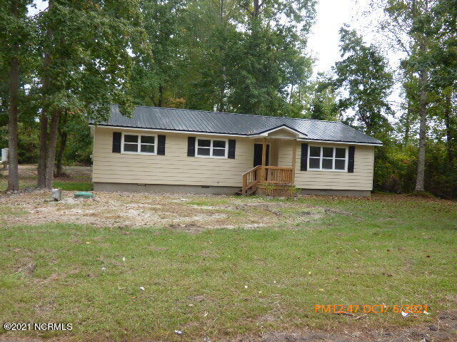 Owner has completely redone the home.  For practical purposes it is a new home.  New roof, flooring, cabinets, appliances, fixtures, deck, porch, etc.  This 3 bedroom 2 bath home on an almost 1 acre corner lot is located in a rural setting yet just a short distance from Camp Lejeune and Jacksonville.