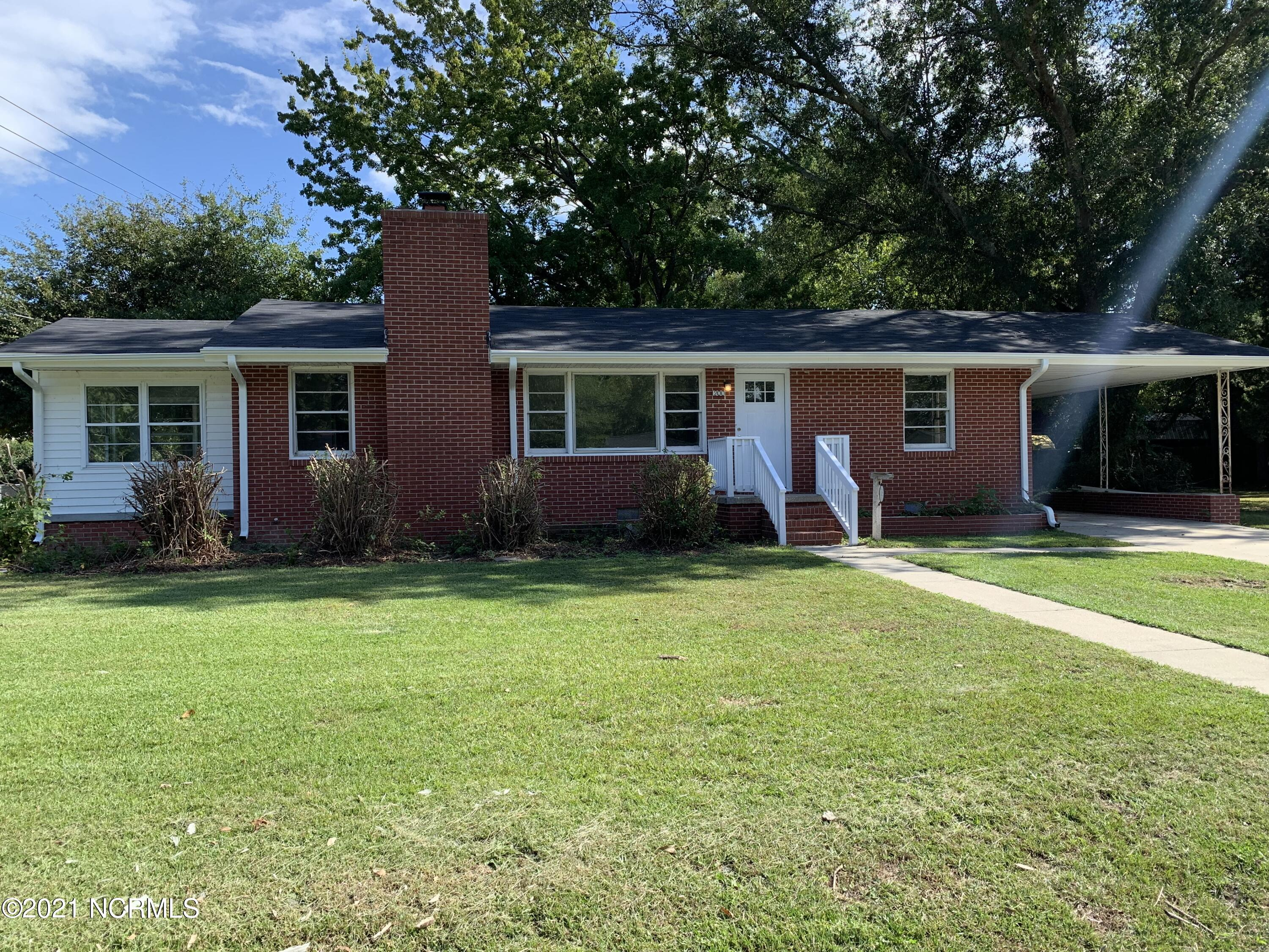 Cute freshly painted 3 bedroom, 1 & 1/2 bath home with car port located in the heart of Jacksonville.  Open floor plan with Living/Dining area has a fireplace for those cold winter nights that opens up to sunroom. Open floor plan with remodeled kitchen with white cabinets, granite countertops and large island. Stainless steel appliances. This home also features LVP flooring throughout the house. New HVAC unit. 1/2 bath and Laundry room has separate entry (for an additional 54 ft not included in total square footage). Shed for extra storage.  Conveniently located close to shopping, restaurants.
