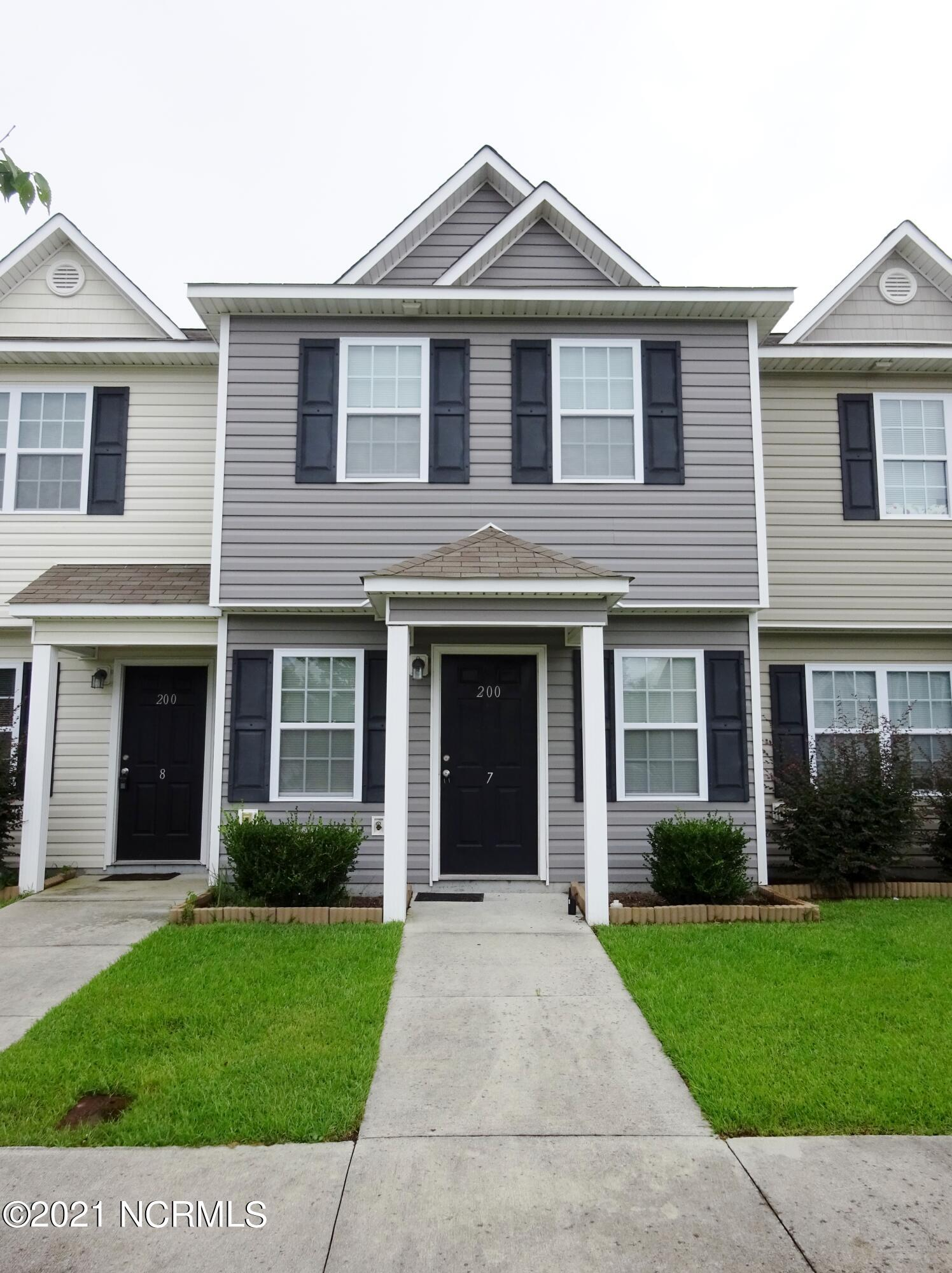 Great location, great home, great price! Perfect location to the back gate of Camp Lejeune!! Open floor plan downstairs with the living space open to the kitchen complete with breakfast bar. Upstairs features two bedrooms each with their own bathroom. Washer/ dryer included (as is). Rear deck with attached storage closet.