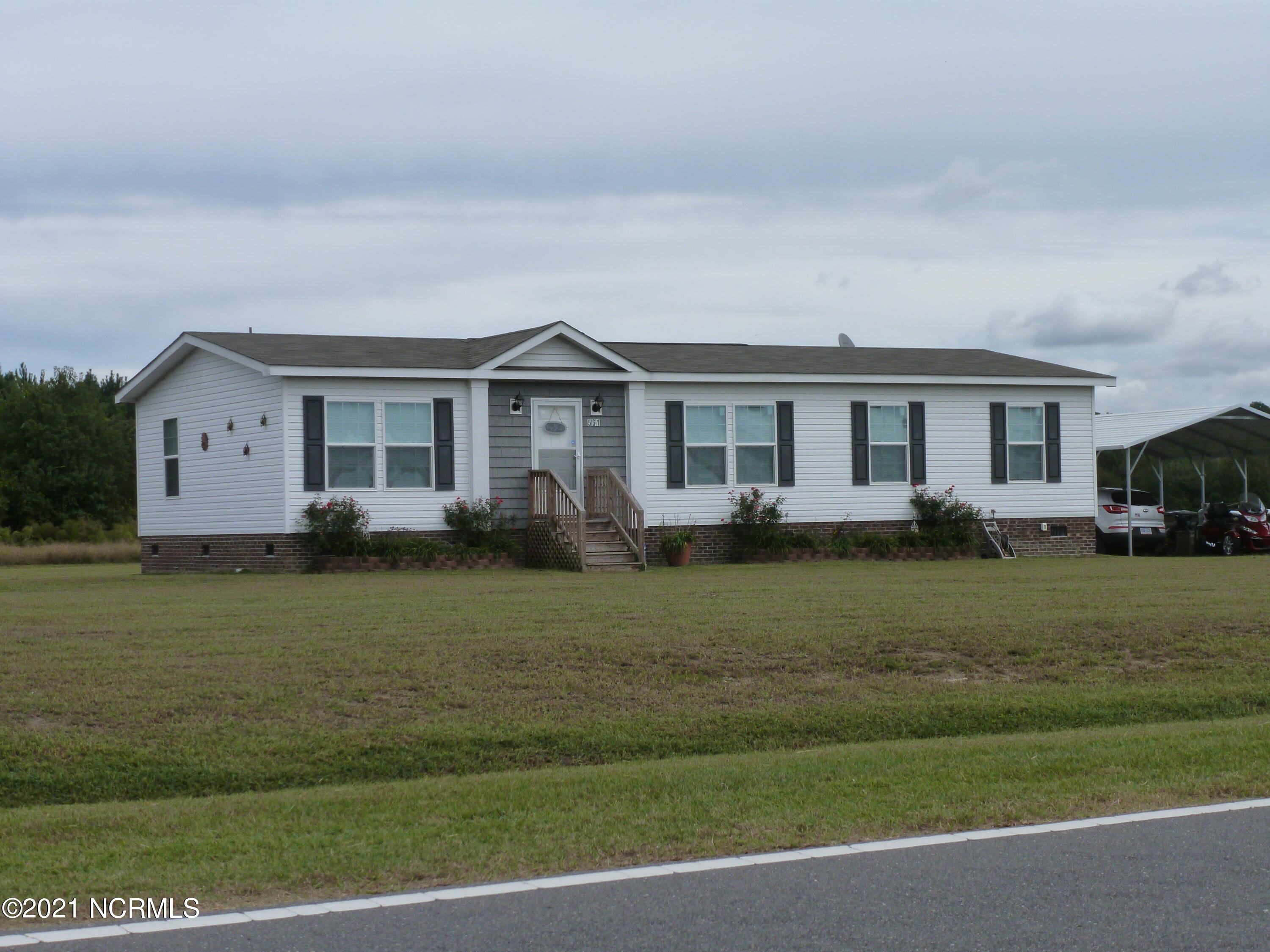This is a Modular Home that is barely three years old! It has 3 bedrooms and 2 bathrooms. It sits on .86 acres and is right off of highway 24. The home has an open floor plan with carpet and vinyl throughout the home. There is a twelve by sixteen deck attached to the home. This home is in excellent condition and will not stay on the market long.