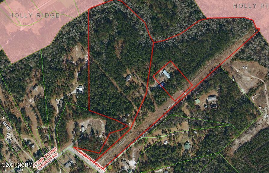 Looking for seclusion or maybe a Potential Development? Check out this 34.63 acre land tract just outside the Holly Ridge city limits. Zoned R-15A. Property is in Holly Ridge ETJ. County water available, county sewer line runs through the property as well. 2 septic systems and 1 water tap already in use on the property. Owners are actively working on covenant changes to maximize development potential. Check it out and schedule a showing to see this property up close.