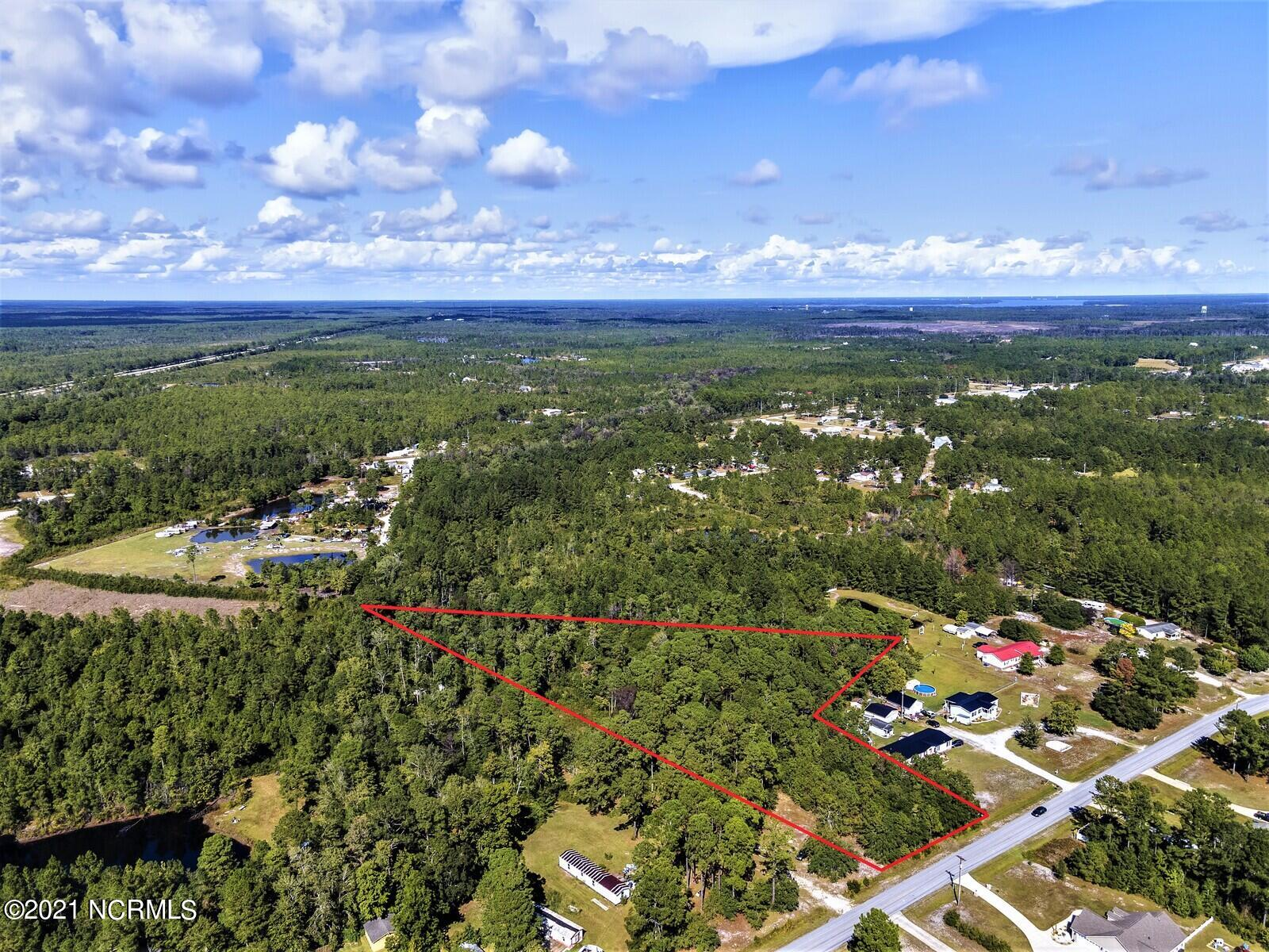 3.31ac situated in coastal NC right off US Hwy 17 on Old Folkstone Road seeking new owners. This parcel is conveniently located between Jacksonville and Wilmington, with easy commutes to either town, Marine Corps base Camp Lejeune, or Interstate 40. A survey on file shows 110 feet of road frontage, offering many possibilities, especially since this property is zoned R30M, which only calls for 30,000sqft lot minimums, with manufactured homes allowed! None of the land is in a special flood hazard area and there are no septic permits on file. Holly Ridge is located just minutes to the beaches of Topsail Island, the schools are within 10 minutes away, and the coastal lifestyle is waiting on you... call a Realtor for more details today!