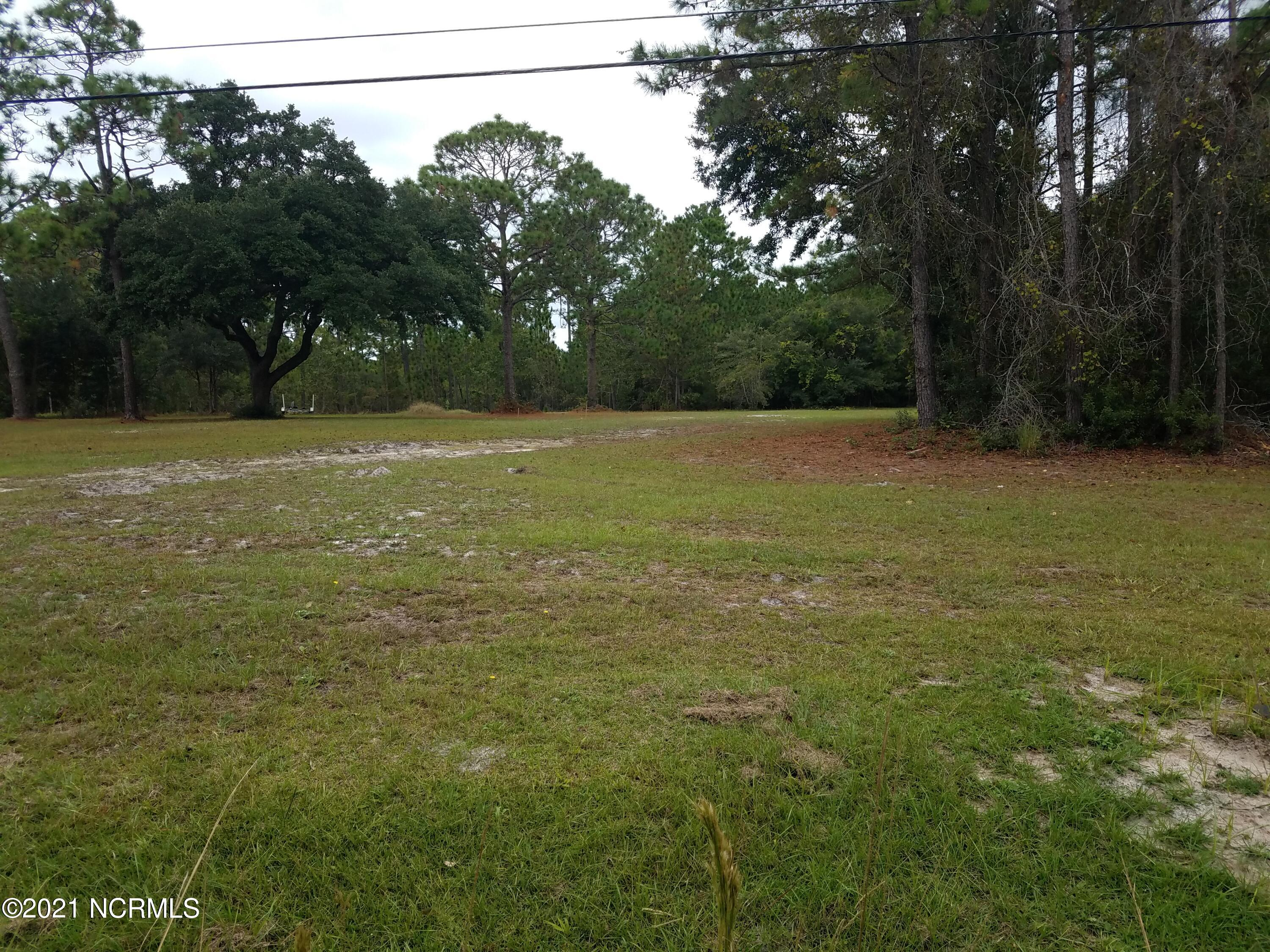 Very Nice .46 acre  level cleared building lot just minutes from Surf City. Water tap has been paid for with Town Of Holly Ridge. Sellers have had Pittman Soil Consulting out to the property and have plans drawn up for 3 bedroom septic system (See documents for proposed septic system). A Must see!!!