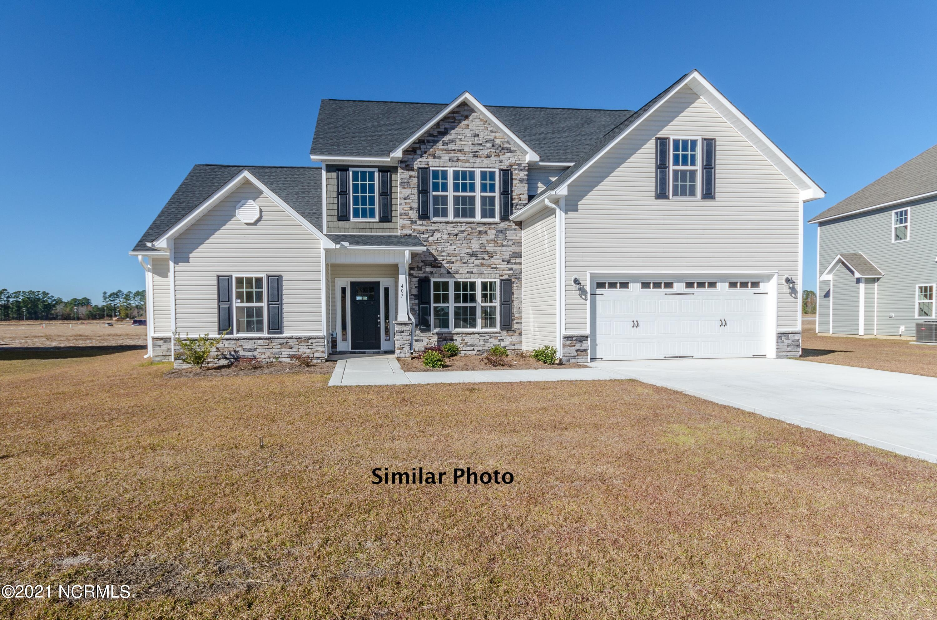 Welcome to Jacksonville's hottest new community, Stateside. Located off of Gum Branch Road behind Stateside Elementary School. All new construction by Onslow County's most trusted and preferred Builder featured in Builder 100/ Top 200 Home Builders in the country. Stateside is 16 miles to Camp Lejeune, 12 miles to New River Air Station and minutes to area schools and shopping. A beautiful new community for active and growing families. Upcoming community amenities will include clubhouse area and community pool. Introducing the Berkley floor plan which boasts with 5 bedrooms and 3.5 bathrooms at approximately 2920 heated square feet. The outside comes equipped with easy to maintain vinyl siding, accented by stone or brick, with a sodded front yard.  Welcome your guests into your home in your two story foyer.  The formal dining room is the perfect place to gather for special events and family meals.  The chef in the family is sure to fall in love with the kitchen.  Flat panel staggered cabinets, large pantry, an island for food preparation and a stainless steel appliance package to include the dishwasher, microwave hood, and smooth top range.  Enjoy your morning cup of joe in the open breakfast nook.  Movie nights made simple in the large family room.  Complete with ceiling fan and electric fireplace surrounded by marble and topped with a custom mantle. Convenient first floor master suite allows for privacy and relaxation.  The master suite features ceiling fan and master bathroom.  The master bathroom includes a double vanity with cultured marble counters and custom mirror, water closet, separate shower and soaking tub.  Follow through the master bathroom to the ENORMOUS master walk-in closet.  Upstairs you will find the remaining 4 bedrooms and 2 bathrooms, all perfectly sized and pre-wired for ceiling fans.  Bedroom 5 features a sitting area.  Wander outside to your covered back patio, the perfect place to gather for BBQ's or those warm Carolina evenings.  Your two 