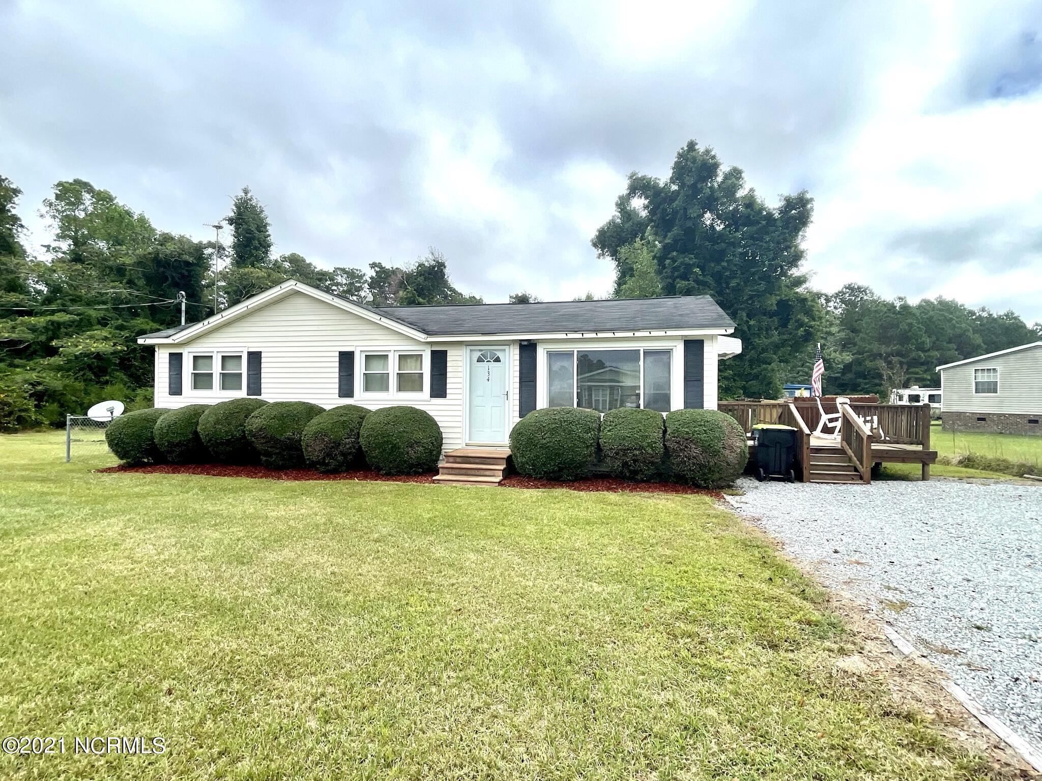 Cozy cottage home with open concept living room and kitchen. Spacious side porch and large backyard. All on one level. LVP flooring throughout. Butcher block island, new water heater, 4'' gravel driveway. Tons of potential to make it your own with NO CITY TAXES.
