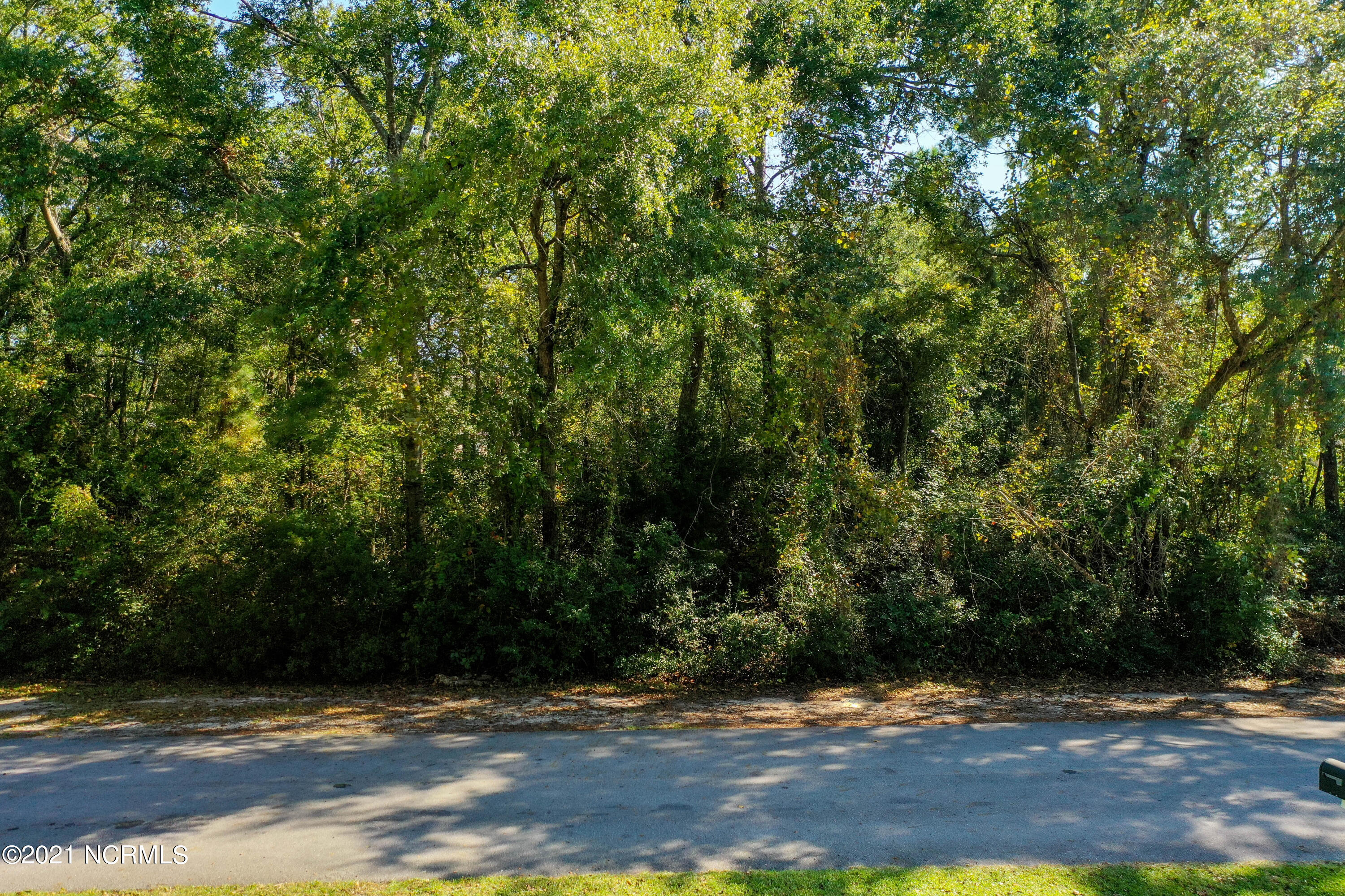 Build your dream home in the gated community of Chadwick Shores.  Lot  is .35 acres and has 105 feet on the road. Seller has an expired septic permit.