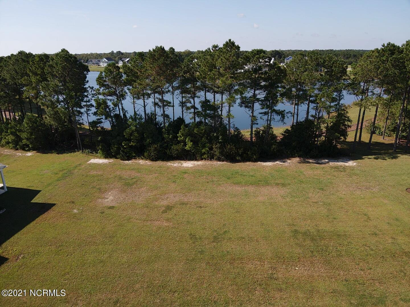 Vacant lakefront homesite, ready to build in luxury waterfront community of Summerhouse on Everett Bay! All the amenities are in place in this idyllic neighborhood, featuring a huge clubhouse, pool, fitness center, day docks, boat ramp, boat storage, pickle-ball court, tennis court, basketball court, running trails, playground, and more! With our Featured Builders, you can design your coastal home and start living the beach life in no time! Call today for more information!