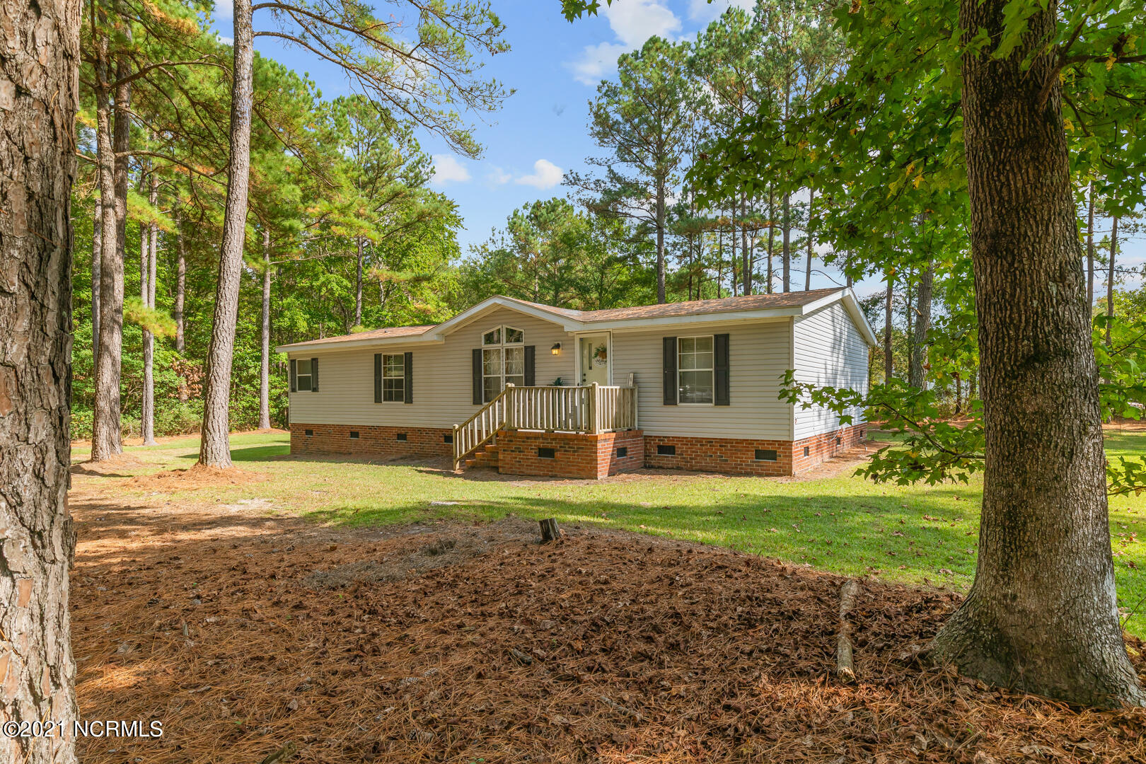 The gem has just hit the market. This is a manufactured home on a permanent brick foundation tucked away on 1 acre of land.  This home has 3 bedrooms and two full baths.  As you enter the side entrance you will find the laundry room which leads into kitchen with a nice pantry.  The master bedroom has a nice bonus sitting area off to the side which could be used for many things, baby crib, craft space, reading area, etc.  This home is off of the main roads, so you should have very little traffic and lots of privacy.  You must see this to truly appreciate all it has to offer.