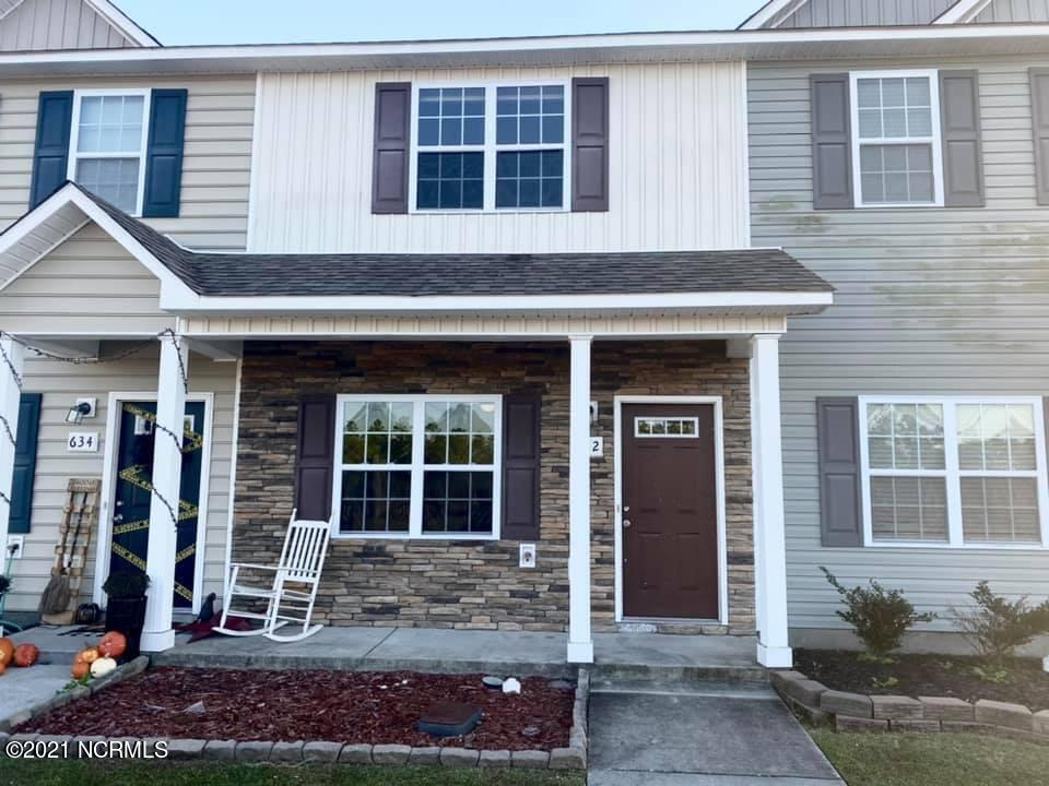 Fall in love with this 2 bedroom townhome in Oyster Landing! Conveniently located close to the back gate of Camp Lejeune, Stone Bay and the local beaches and restaurants, you'll love what the Sneads Ferry community has to offer! On the first floor, there's a spacious living room, half bath and an eat-in kitchen that offers a breakfast bar with rustic charm, plenty of cabinets and a pantry! Upstairs, NEW CARPET just installed Oct 2021! Each bedroom has an ensuite bathroom, with dual sinks in the primary suite along with a walk-in closet. Outside, you'll be able to relax on your covered patio in your fenced in backyard! As an added bonus, you'll be able to cool down in the Summer at the community pool just a hop, skip and a jump away!