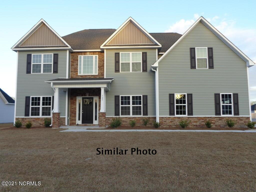 """Welcome to the highly desired and popular community of Onslow Bay. Brand new construction built by Onslow County's most trusted and preferred builder, featured in Builder 100/ Top 200 Builders in the country. Onslow Bay is a hot spot, 3 miles to MCB Camp Lejeune's Piney Green gate, 14 miles to New River Air Station and minutes to area schools, shopping and dining. This beautiful neighborhood is sure to impress, complete with a clubhouse area and community pool. Introducing the Haley floor plan which features 4 bedrooms and 2.5 bathrooms at approximately 3,350 heated square feet. Situated on a gorgeous lot, the curb appeal is exquisite! Easy-to-maintain vinyl siding, accented by stone or brick. All surrounded by a sodded front yard with a clean, classic landscape. The spacious 2 story foyer welcomes you in, opening to the formal areas. Formal living room and formal dining room are perfect for hosting those special occasions. The chef in the family is sure to fall in love with the kitchen! Open and spacious with an ample amount of cabinet and counter space, and a bar for extra seating. Stainless appliances include a smooth-top range, microwave hood, and dishwasher. Enjoy your morning coffee in the keeping room with a cozy fireplace. Gather everyone together for movie or game night in the family room. The expansive 24'x19', the family room boasts plenty of natural lighting, a ceiling fan, and a second electric fireplace, surrounded by marble and topped with a custom mantle. The impressive master suite is approximately 14'x15' ceiling fan, and 9'x8' sitting area. """"Get away from it all"""" in the luxurious master bathroom. Two vanities topped with cultured marble counters, full view custom mirrors, ceramic tile flooring, separate shower and soaking tub, and linen closet all leading to a HUGE walk-in-closet - you must see to believe!! Bedrooms 2, 3, and 4 are perfectly sized and prewired for ceiling fans. Bedroom 4 boasts a walk-in-closet and full bathroom. Separate laundry """