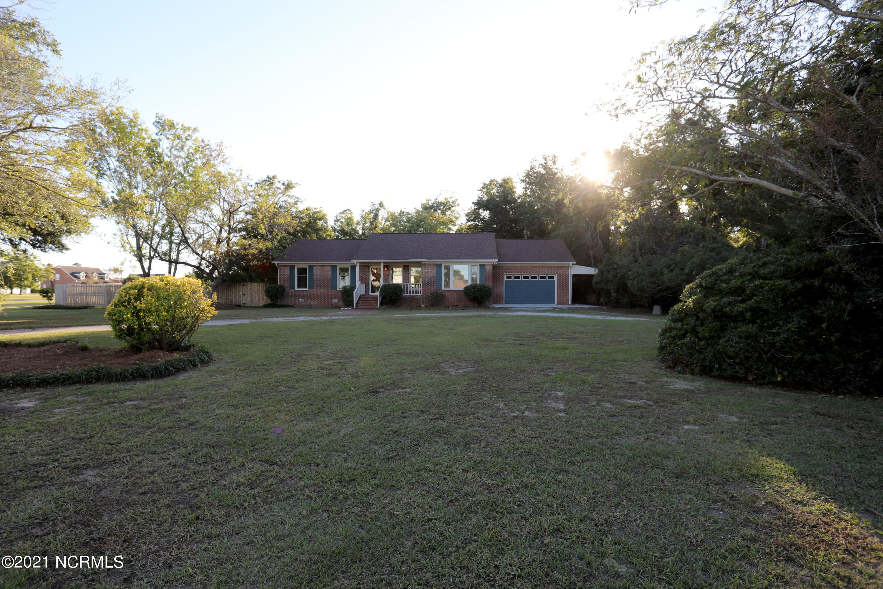 Lovely brick home located on a corner lot with a POOL!   Great location, just down street from Shell Rock Wildlife Boat Ramp  and the home boasts water views from the front and the back. Not only a traditional ranch style home but it also has a bonus room with a full bathroom.  That is a total of three full baths, a formal living room, a family room and a bonus room.  All of this with a great yard, a huge deck and an inground swimming pool with a diving board.  There is an extended pull-through garage and a covered carport.  Water well is for outside watering.  Call today for a showing.