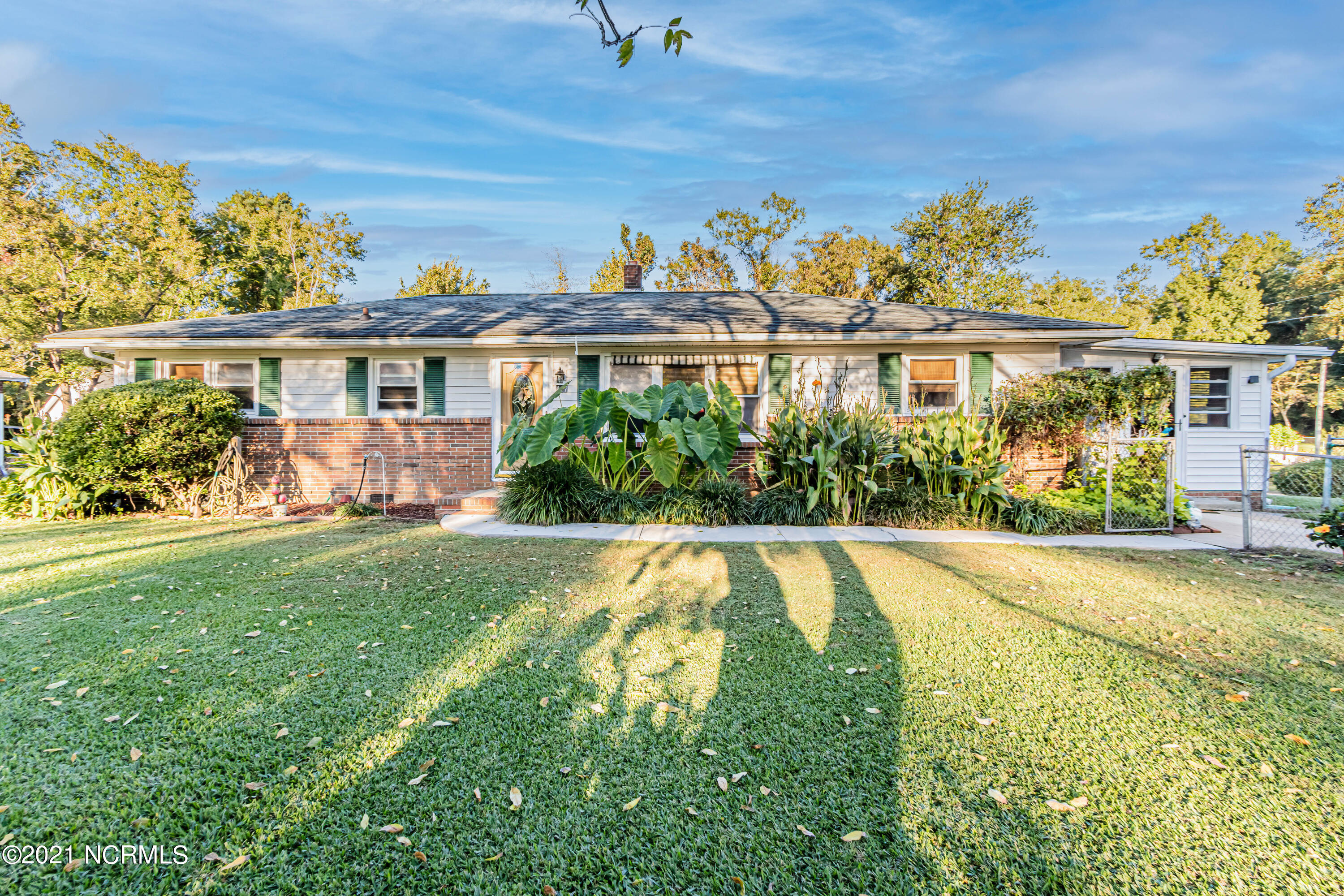 Perfect starter home in the Jacksonville city limits! This 3 bedroom, 1 1/2 bathroom home sits on a corner lot you are sure to appreciate. A few noted features of this home include a fully enclosed side porch/Florida room, a separate bonus room that can be used as a fourth bedroom or an office, a large eat in kitchen and another enclosed back porch with skylights leading to the back yard! Sitting on .41 acres in a quiet subdivision, you will love the convenience of being close to it all! HVAC and ductwork were replaced just one year ago. Call today for a showing!