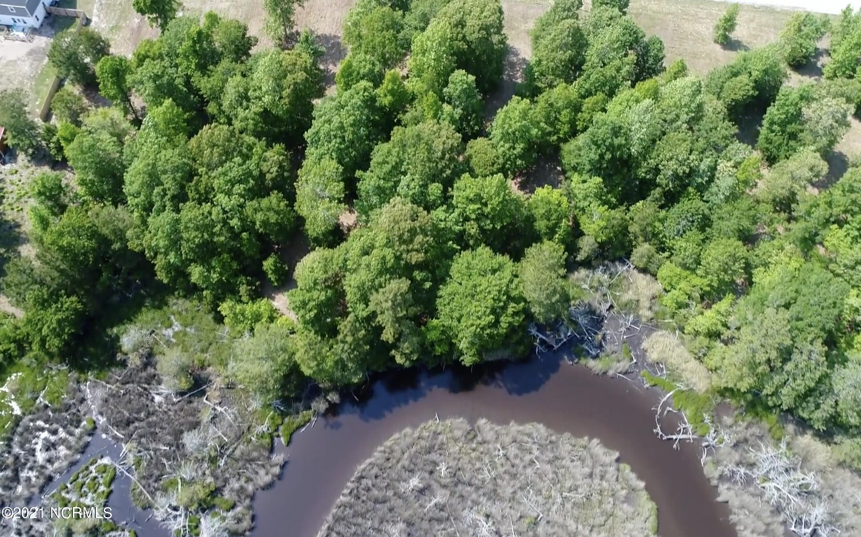 Beautiful and serene 2.27 acres with no restrictions and amazing waterfront views. Minutes to Camp Lejeune and local beaches, this lot is the perfect spot to build the home you've been dreaming of. Water depth will suit a skiff.  No HOA and no restrictions. Also offered with 260 Everett Yopp Drive for a total of more than 4.5 acres for your own private estate. Lot is also subdividable for two homesites.  Be sure to view the aerial video tour.