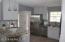Granite, Pendant lights, breakfast bar, stainless steel, decorative backsplash
