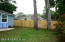 Recently replaced 3'-6' privacy shadow box fence. Vinyl siding on all sides.