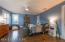 Large third bedroom with en suite bathroom designed by Ellen Dyal