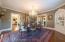 Original dining room chandelier and built in corner cabinet