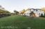 Sunset at 1999 River Road-large flat backyard for lots of outdoor play and entertaining.