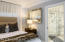 Guesthouse boast Carrara marble floors & custom bathroom ,morning kitchen and tongue & grove ceiling.