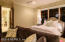 Generous Owner's Suite features beautiful wood windows, warm Brazilian cherry wood floors and custom doors to en suite spa bath.