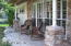 Front porch tiled flooring and stone accents