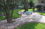 Beautiful landscaped front yard with rock garden and bench