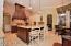 Beautiful Granite counters and Travertine stone floors