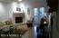 19' 10 x 14' 7 laminate floors, cathedral ceilings and fireplace