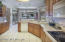 Kitchen with Corian counters and custom, solid wood cabinets