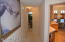hallway connecting 2-4 bedrooms