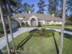 TO 16 FT CEILINGS, NEWLY REMODELED KITCHEN,WOOD & TILE FLOORS, UPDATES, PLANTATION SHUTTERS THROUGHOUT, POOL,LAGOON, & GOLF VIEWS