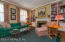 This space is located off the den and is the ideal space for reading or studying! Set this space up as you wish - would make an ideal home office as well!